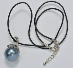 AYNX2643:             Classic Design Round Shape 16mm Blue Black Seashell Pendant Necklace, length 17.7inches.                                      This necklace is handmade and the seashell is unique.                                     Symbolism:              Seashell is said to bring protection when worn around the neck or in the pocket.  Special $13.00  Please note this is a LIMITED EDITION ITEM buy while supply last.