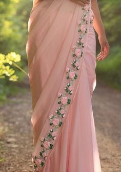 PRODUCT DESCRIPTION: Featuring a balmy baby pink pure chiffon saree with beautifully embroidered satin pink rose vines along the edges.How to make ribbon work sareeVintage style chiffon sari with ribbon embroidery. Chiffon Saree, Saree Dress, Silk Chiffon, Satin Saree, Floral Chiffon, Indian Dresses, Indian Outfits, Indische Sarees, Cocktail Dresses