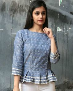 Shop online Jade blue ikat peplum top A peplum with the right twist of ikat. Contrast white ikat stripes on the sleeve and on the subtle frill of the top. Buttons are stylishly placed on slightly one side in an overlap fashion. Short Kurti Designs, Kurta Designs Women, Blouse Designs, Dress Designs, Peplum Top Pattern, Peplum Tops, Peplum Blouse, Indian Tops, Kurta Neck Design