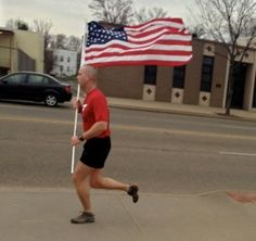 This looks so like my son also in the ANG.  I know he'd do this as well.  Army National Guard 2nd Lt. Gabe Pszonowsky, 35, ran w/ an American flag from West Market Street to the University of Akron campus & around campus & back as part of Team Red, White and Blue Tuesday to show solidarity for Boston and the country on Tuesday. (Photo courtesy Georgie D'Kay)