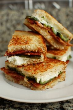"Jess will live this! Jalapeno Popper Inspired Grilled Cheese! These were super easy and totally delish! I used cream cheese instead of goat cheese and using sourdough bread is a MUST, but these little finger sandwiches (when quartered) ended up on everybody's ""favorite's list!"""