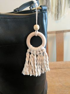 Check out this item in my Etsy shop https://www.etsy.com/listing/499511983/boho-wood-hoop-macrame-keychain