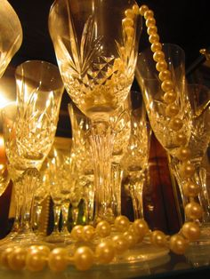 Amber light shining on crystal glassware & pearls