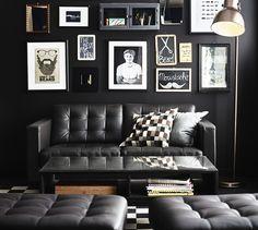 IKEA LANDSKRONA skinnsoffa i svart läder med fotpall.