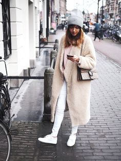 Grey beanie, cream teddy coat, white jeans & white sneakers