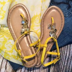 YELLOW SHELL EMBELLISHED FLAT SANDALS Super cute sandals in beautiful yellow adorned with shells down the strap. Like new Michelle D Shoes Sandals