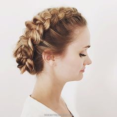 Loosened Dutch braids on each side, pulled together at nape of neck. Twirled and tucked into a sorta-bun.