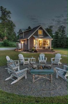 I want a fire pit like this. Love it with the gravel and the chairs sound it. Perfect