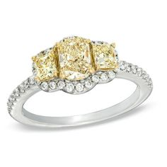 This ring showcases a trio of princess-cut certified yellow diamonds aligned across the center.