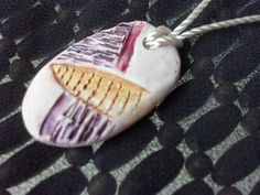Vibrant Texture Handcrafted Polymer Clay Pendant with Acrylic Wash. $16.00, via Etsy.