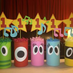 Yo Gabba Gabba centerpieces made from oatmeal cans. Could nix the number and stick a balloon weight inside!