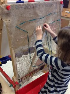 Great easel provocation. Previous pinned had great idea for adding paint and found materials.