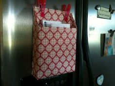 A cereal box wrapped like a package with scrapbook paper and magnets for holding mail! perfect