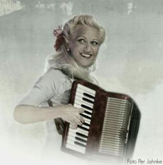 Gunhild Carling, Swedish multi-instrumentalist and singer, playing the accordion...
