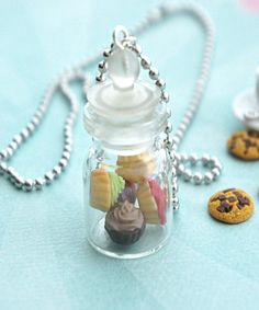 This necklace features a miniature jar of handmade strawberry cupcakes sculpted from polymer clay. The glass jar measures about cm tall and is securely attached to a silver tone ball chain necklace that measures in length. Bottle Charms, Bottle Necklace, Cute Necklace, Kawaii Jewelry, Cute Jewelry, Unique Jewelry, Magical Jewelry, Kids Jewelry, Polymer Clay Miniatures