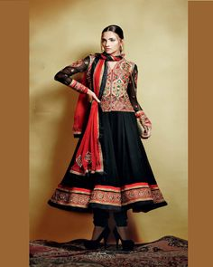 Charcoal and Cherry Red esemble in 'anarkali' style.Fabric is pure georgette with chiffon dupatta.Red jacket with traditional geometric embroidery in golden thread.