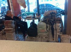 A senior sitting in McD with lots of recycled paper.