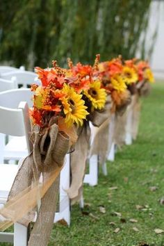 I made these aisle decorations for our October wedding. They turned out beautiful. I have 10 of them, five had orange tulle with burlap bows and the other 5 have brown tulle with the burlap bows all with a large sunflower and fall leaf background. At the end of the aisle, was an Amish made arbor with fall décor.  Was absolutely beautiful!