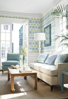 Bimini Ikat #wallpaper in #blue & #green. Madison Sofa from #ThibautFineFurniture in Straw. Pillows in Bimini Ikat #fabric in #blue & #green and dyed Sack #fabric from #AnnaFrench English Linens. Mayfair Chair from #ThibautFineFurniture in Sausalito #fabric in #aqua. Rinca #fabric in #Aqua, #Green #Blue. #Thibaut