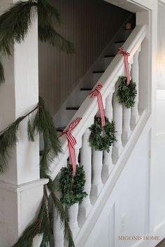 boxwood wreaths and garland on stairway