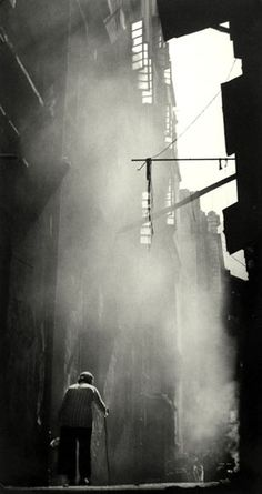 "Fan Ho:    ""born in Shanghai in 1937, but immigrated with his family to Hong Kong at an early age. Ho began photographing at a very young age with a Rolleiflex camera his father gave him. Largely self-taught, his photos display a fascination with urban life, explored alleys, slums, markets and streets, depicting the street vendors and children only a few years younger than himself. He developed his images in the family bathtub"""