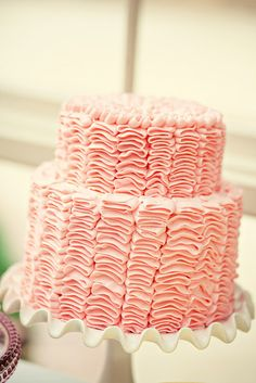 Pink Ruffle Cake I would add a huge gumpaste flower to the right. Pink Ruffle Cake, Ruffled Cake, Pink Frosting, Buttercream Ruffles, Ribbon Cake, Specialty Cakes, Occasion Cakes, Mini Desserts, Fancy Cakes