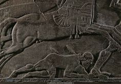 Assur Relief. Fallen warrior under a horse. Detail of King Ashurnazirpal and his standard-bearer in a chariot charge against the enemy. Stone bas-relief (9th BCE) from the palace of Ashurnazirpal II in Nimrud, Mesopotamia. British Museum