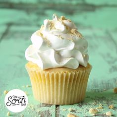 A mango curd-filled vanilla cupcake topped with a swirl of meringue frosting is the stuff of sweet dreams.