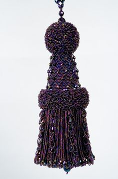 Beaded tassel: peyote stitch over wood core, fringed.
