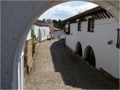 Cobblestone passage under the arch, Guatavita, Colombia