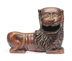 A POLYCHROME CARVED WOOD LION POSSIBLY ENGLISH, C16th.
