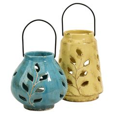 Set of two ceramic lanterns with vine cutouts. <3