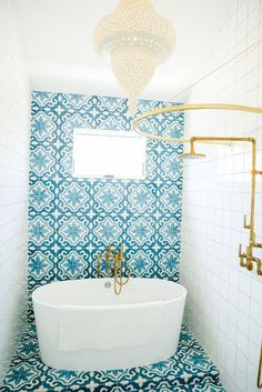 blue & white bathroom tile, brass fixtures, by Leanne Ford Interiors
