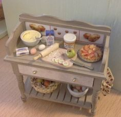 Dollhouse table to make a delicious apple pie made by Jolanda Knoop