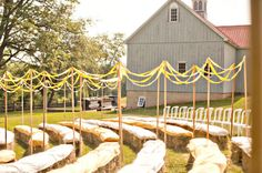Hay Bails with cloth and a row of chairs in back...exactly what I described LAUREN!