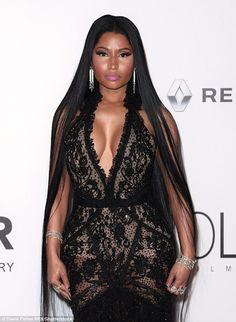 Nicki Minaj wears extreme plunging lace gown to attend amfAR gala #dailymail