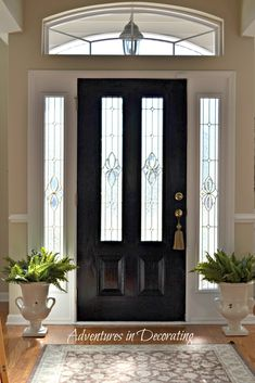 "Paint the front door black for a little bit of drama!-already have my primed bc i had a dark stain on it. But i can attest, it makes a difference. I am also painting my garage door and patio door black. Helps cut down on the ""dirty white door"" look."