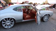 "video of 1972 Oldsmobile Cutlass on 24"" Savini Forged Wheels, 72 Oldsmobile Cutlass, sitting on 24"" Savini Forged Concave Wheels. shop is ""Stitched By Slick"" (look up on Instagram, etc). SUPER clean car, custom interior. Has orange leather and suede interior. With a new school, Infiniti dash swap. And custom door panels to fit the dash. brown, savini wheels concave brushed multi spoke"