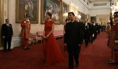 The Duchess of Cambridge is wearing a Jenny Packham bespoke red gown with cap sleeves with sequins, some lace overlay, at least in bodice, and full skirt along with the Lotus Flower tiara for the state banquet at Buckingham Palace for Chinese President Xo Jinping, October 20, 2015.