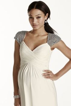 This stunning on-trend beaded cap sleeve jersey casualmaternity wedding dress defines style and comfort!  Long jersey maternitydress features flattering sweetheart neckline and heavily beaded cap sleeve shoulders.  Empire waist, A-line silhouette is flattering on every figure.  Long, soft jersey skirt provides ultimate comfort on your special day!  Available in Ivory.  Fabric: Jersey/body: 92%polyester/8% spandex. Lining: 100% polyester.  Fully lined. Back zipper. Dry clean only....
