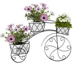 Blomkrukor på cykel