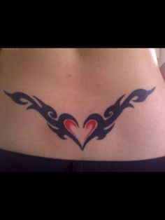 Lower back heart and wings tattoo