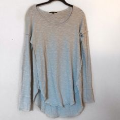 Urban Outfitters Sweater NEVER BEEN WORN BEFORE!!!!! It is a light blue color. It is size small. It is long so I recommend this for people who want a long sweater. I recommend for sizes small and medium. It has little threads of fabric all around the end of the shirt and the cuffs of it. It is a long thermal knit! Can negotiate price. Urban Outfitters Sweaters Crew & Scoop Necks