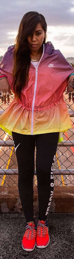 Sit back and welcome summer in non-stop warm weather style. The Nike Track & Field Sunset Poncho.