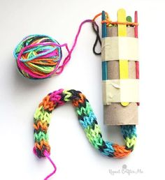 """""""With a cardboard roll, popsicle sticks, and fun variegated yarn, you can create a knitted snake! Great project for the kids and a boredom buster during…"""""""