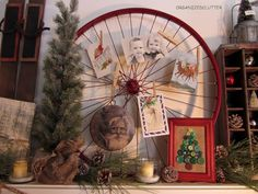 Display cards using an old bicycle wheel - vintage rustic christmas mantel, christmas decorations, repurposing upcycling, seasonal holiday decor, Bike rim spray painted red with photos and vintage Christmas postcards My framed button tree Christmas Card Display, Christmas Love, Country Christmas, Vintage Christmas, Christmas Holidays, Christmas Crafts, Christmas Postcards, Christmas Ideas, Vintage Sled