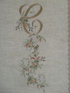 MONOGRAM: C, with trailing flowers.
