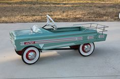 aqua pedal car. That's a beautiful pedal car.