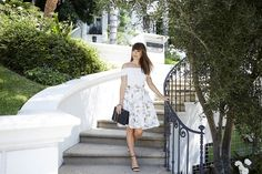 The Power of Femininity | Margo and Me. White off the shoulder top+white floral dress+black ankle strap heeled sandals+black shoulder bag. Summer event outfit 2016