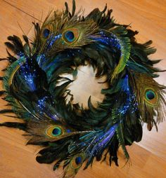 One of the most magical DIY Light Crafts I've ever done: THE FINISHED PRODUCT of LED Light Up Fiber Optic Hair clips added to a peacock feather wreath. Helpful hints to make your own at link. Peacock Wreath, Feather Wreath, Peacock Decor, Peacock Feathers, Peacock Colors, Pheasant Feathers, Xmas Wreaths, Spring Wreaths, Birthday Gift Bags